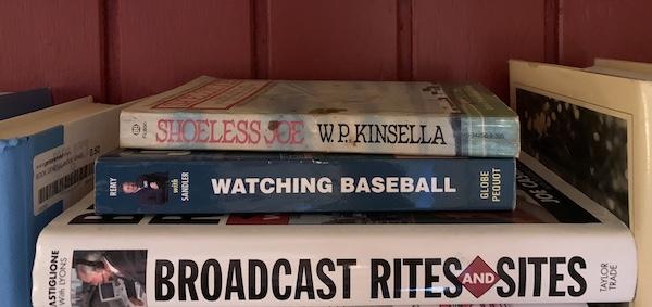 Baseball-themed books on a shelf